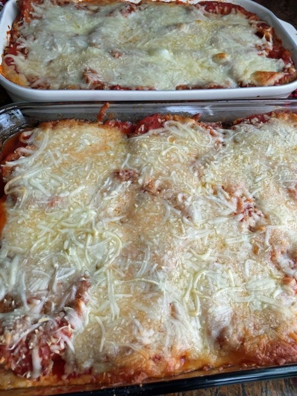 Eggplant parmesan recipe - the best you have ever eaten - two trays of baked eggplant parmesan.